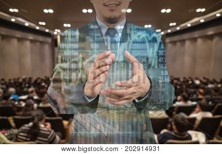 Double exposure of businessman clapping and smiling over the trading graph on Abstract blurred photo of conference hall or seminar room with speakers on the stage business investment success concept, 3D illustration