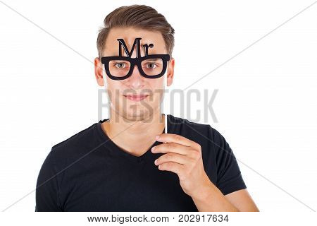 Handsome young guy posing with MR glasses in photo booth - isolated