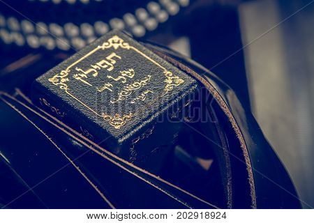 Jewish ritual object, prayer vestments, Tefillin with a hebrew inscription - the arm tefillin. Toned image