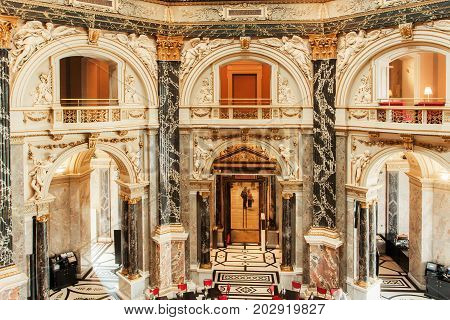 VIENNA, AUSTRIA - JUNE 10, 2016: Great interior design of historical Kunsthistorisches Museum with columns and marble balconies on June 10, 2016. Musem was opened in 1891