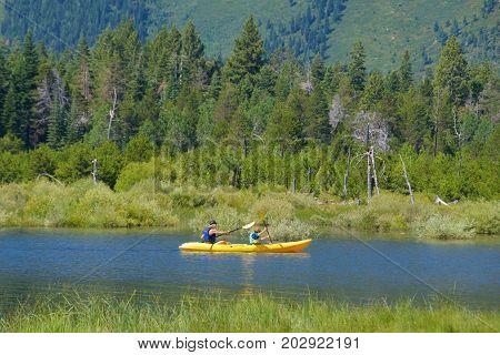South Lake Tahoe, California - August 2017: Men kayaking on the lake in South Lake Tahoe, California