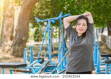 Fitness Fat Women Triceps Stretching Outdoors In Park. Young Asian Teen Girl Exercising Warm Up In M