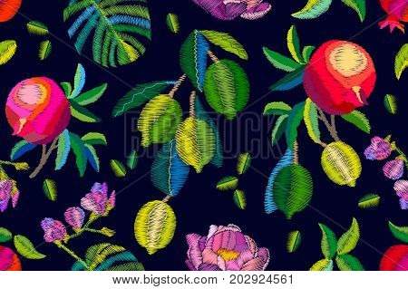 Seamless vector pattern with fruits, palm leaves and flowers. Embroidered texture. Vintage textile collection.