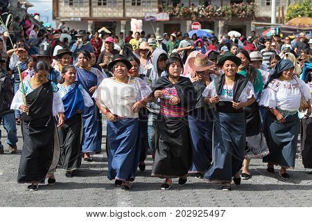 July 1 2017 Cotacachi Ecuador: traditionally dressed Kichwa women dancing on the street during Punchi Warmi celebration