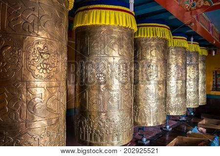 Buddhist prayer drums at monastery Darjeeling, India.