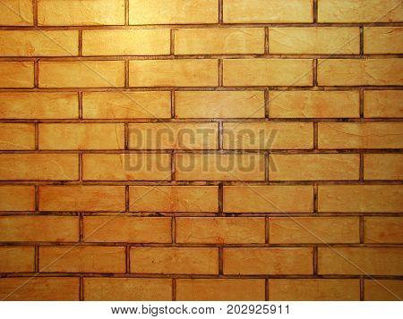 vintage style orange brown tone brick wall detailed pattern textured background: brickwork masonry detail