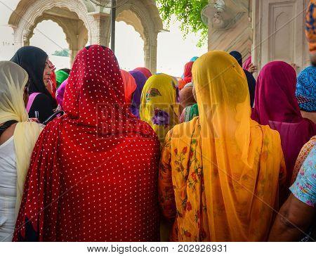 Indian Women Praying At Golden Temple