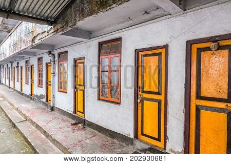 Buddhist monks quarters with yellow doors at monastery Darjeeling, India.