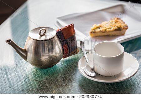 Tea room Darjeeling with tea pot,cup and cake.