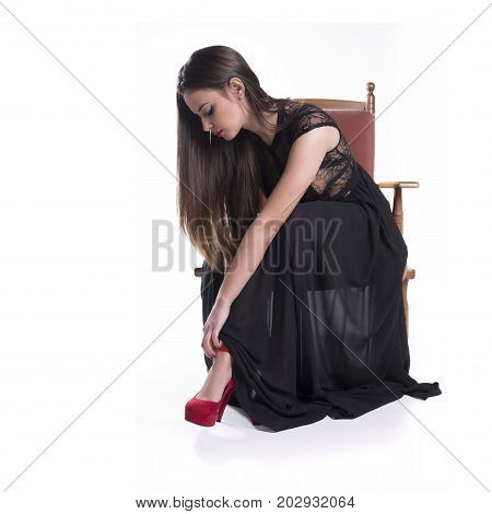 Elegant Model With Black Dress Sit