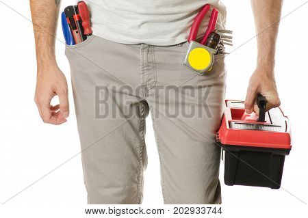 Man in a pocket constructing tools toolbox on a white background isolation