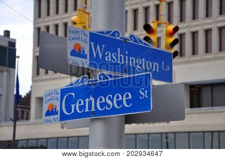 UTICA, NY, USA - FEB. 22, 2013: Road Sign of Washington Lane and Genesee Street in Historic downtown Utica, New York State, USA. This area is a National Register of Historic Places.