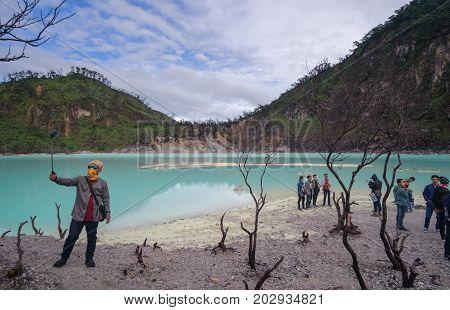 Indonesia West Java June 2017 : People inside the crater of Kawah Putih popular touristic destination Ciwidey Java island Indonesia