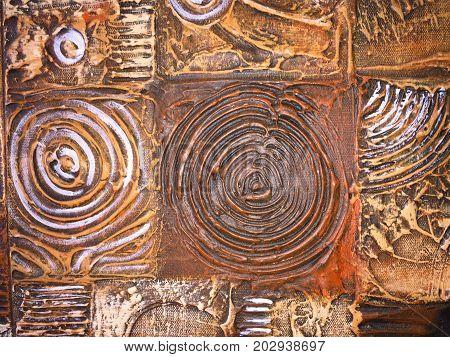 Textura cafe rupestre en espirales o círculos en tonos ocre.