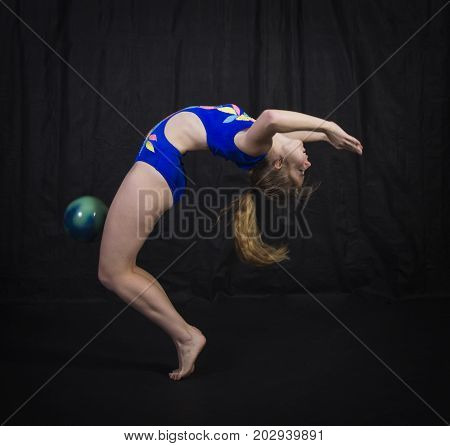 Gymnast Performs Exercises With The Ball.