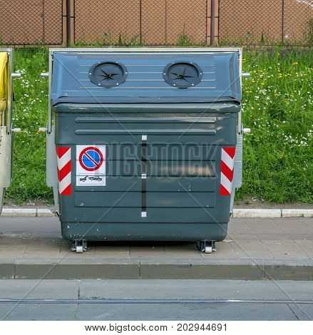 Gray recycling container on the city street