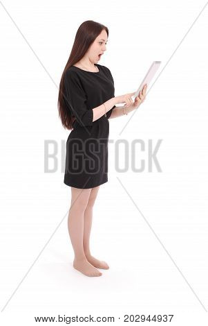 Teenage girl emotions. Girl holds tablet computer isolated on white