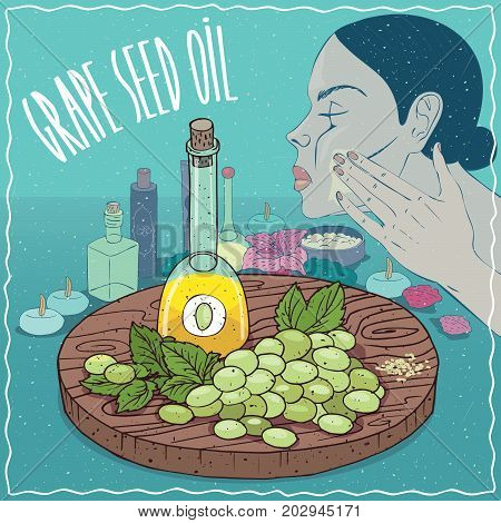 Glass Decanter of Grape seed oil and vine of Grape plant. Girl applying facial mask on face. Natural vegetable oil used for skin care