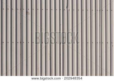 Bare Corrugated Steel Fence Texture Wall. Urban Background.