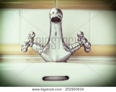 ancient faucet in bathroom, conceptual image, vintage
