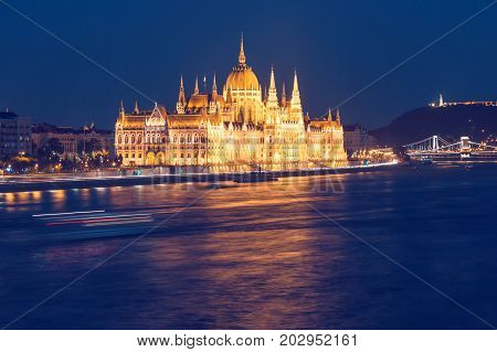 Parliament building of Budapest above Danube river in Hungary at night neo-gothic style architecture