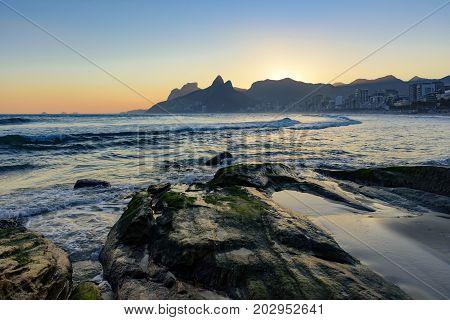 Summer sunset and stones at Ipanema beach in Rio de Janeiro
