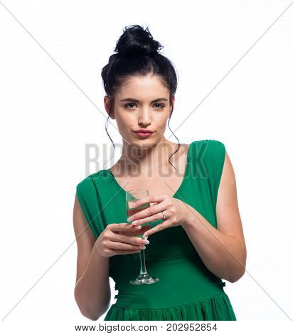 Young woman holding a champagne flute isolated on white background