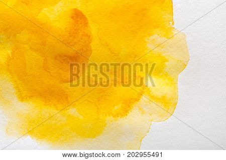 Abstract watercolor yellow and orange spot painted texture background.