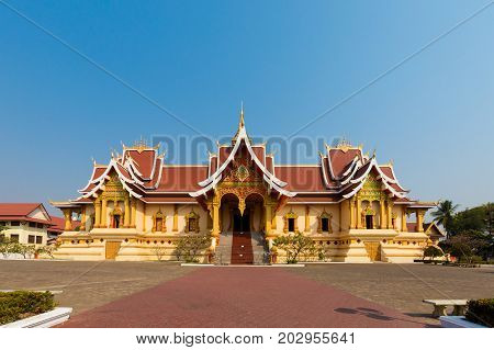 Amazing Wat Pha that Luang temple - the Great Stupa in capital city Vientiane in Laos. History and religius symbols of south east Asia. poster