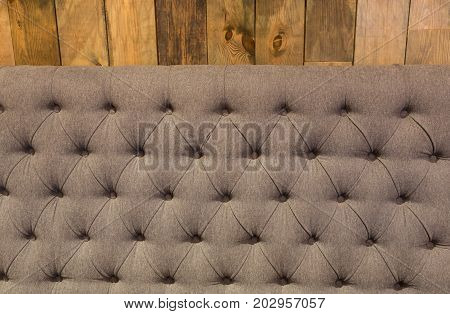 Soft dinning gray table seat in restaurant under wooden wall, copy space