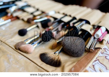 Close up of professional make-up brush cosmetic selective focus. Set of makeup brushes for professional makeup artist. Tools make-up artist in case