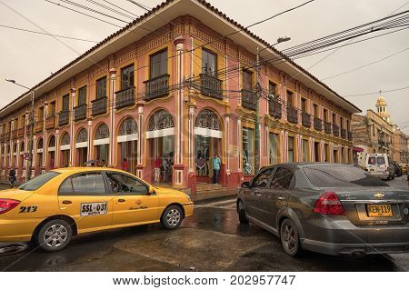 July 10 2017 Buga Valle de Cauca Colombia: midday traffic can get congested on the narrow streets of the colonial town