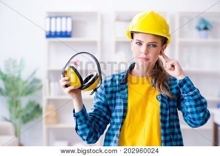 Woman in workshop with noise cancelling headphones
