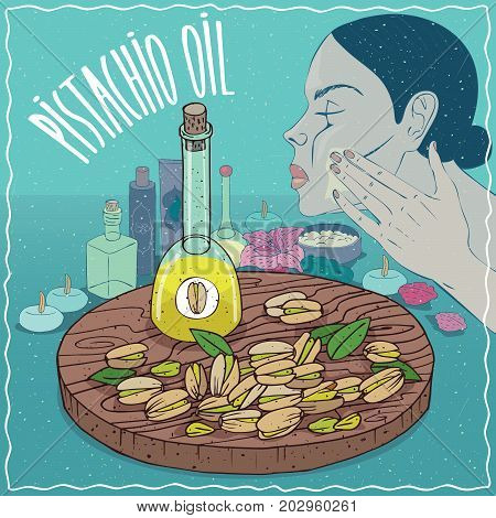 Glass Decanter of Pistachio oil and seeds of Pistacia vera plant. Girl applying facial mask on face. Natural vegetable oil used for skin care