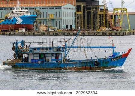 Labuan,Malaysia-Aug 30,2017:Commercial fishing boat in Labuan island,Malaysia.The fishing industry contributes a significant income to islanders here.