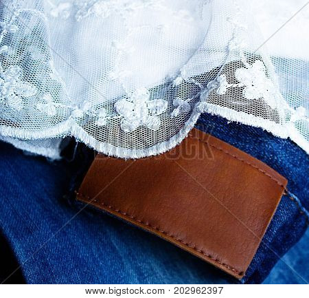 Blue Jeans And White Lace. Denim With Leather Lable And Handmade Lace. Vintage Background Lace And F