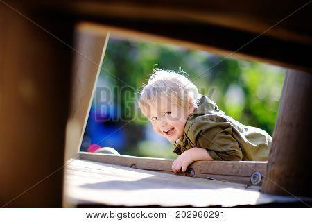 Happy Little Boy Having Fun On Outdoor Playground