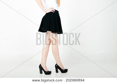 Beautiful Sexy Woman Legs With Black High Heels And Mini Skirt. Schoolgirl In Black Skirt. Fashionab