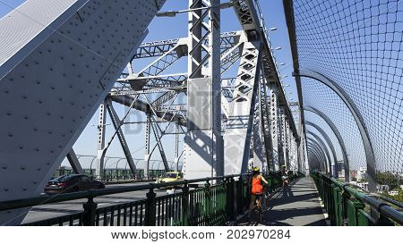BRISBANE, AUSTRALIA - August 29, 2017: Story Bridge a steel truss cantilever bridge spanning the Brisbane River and carrying vehicular bicycle and pedestrian traffic in Brisbane Australia.
