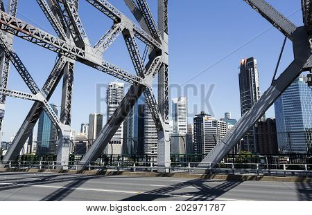 BRISBANE, AUSTRALIA - August 29, 2017: The cityscape seen through the steel trusses of the Story Bridge in Brisbane Australia