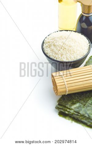 The sushi ingredient. Nori, rice, rice vinegar and soy sauce isolated on white background.