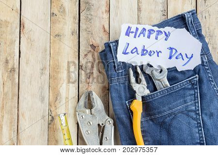 Labor Day is a federal holiday of United States America . Repair equipment and many handy tools with labor day text on background. Top view with copy space for use and design. Business concept.