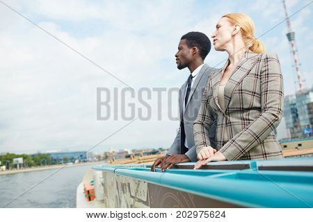 Classy business people on steamship enjoying cruise