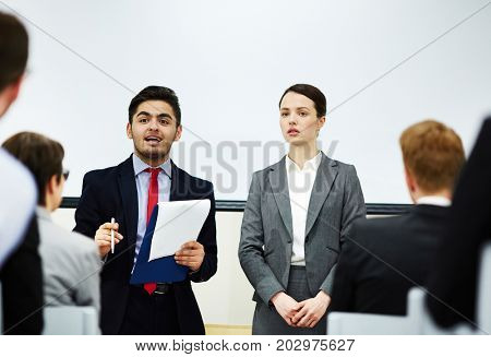 One of speakers interacting with listener after report at conference