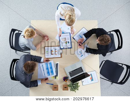 Business people sitting and discussing at business meeting. Business people