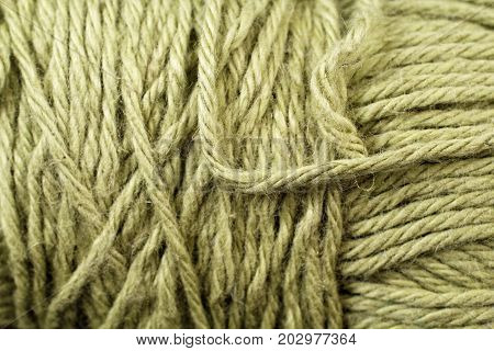 A super close up image of lime green yarn