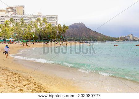 Oahu - July 2012: diamond head panoramic view from waikiki beach with people having fun honolulu hawaii