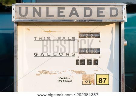 A horizontal composition mechanical gasoline pump dial readout