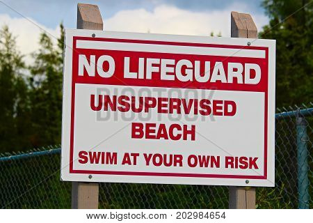 A No Lifeguard Unsupervised Beach Use At Own Risk Sign