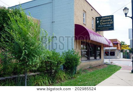 JOLIET, ILLINOIS / UNITED STATES - JULY 20, 2017: Joliet Family Dental accepts Kid Care and Medicaid for dental services.